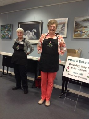 Cathy shows our new aprons
